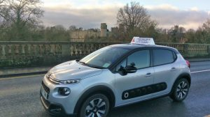 Tim Walsh's Driving School instructor car with Warwick Castle in the background